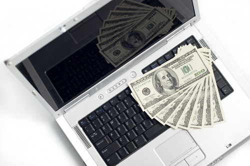 money on a laptop