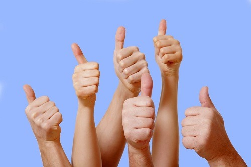 Giving Thumbs Up For Positive Feedback