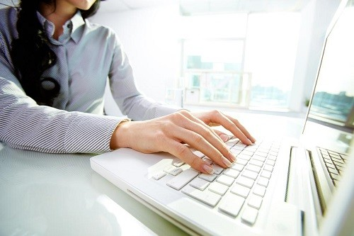 Woman Writing Content on a Laptop